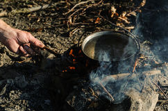 Kettle on charcoal fire. Royalty Free Stock Images
