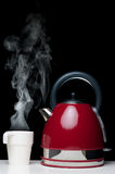 Kettle and cup Stock Photos