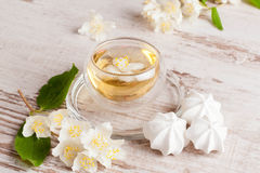 Kettle and a cup of green tea with jasmine, close-up. Horizontal Stock Photos