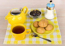 Kettle and cup of hot tea, sugar and biscuits Stock Photography