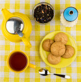 Kettle and cup of hot tea, sugar and biscuits Stock Images