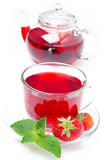 Kettle and a cup of red tea with fresh strawberries and mint Stock Image
