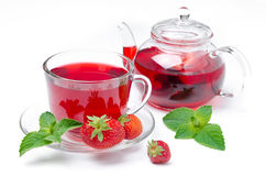 Kettle, cup of red tea with strawberries  Royalty Free Stock Image