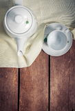 Kettle with cup on table. Kettle with cup on the table Royalty Free Stock Image