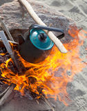 Kettle on the fire Royalty Free Stock Images