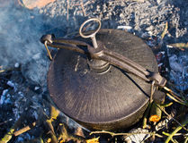 Kettle on fire Royalty Free Stock Image