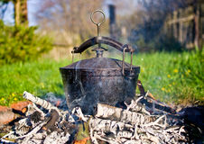 Kettle on fire Stock Image
