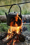 Kettle on a fire Stock Photo