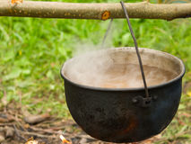 Kettle on fire in a camping Stock Photos