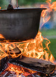 Kettle on the fire , cooking in the nature Stock Images