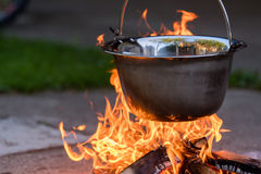 Kettle on the fire , cooking in the nature Royalty Free Stock Image