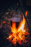 Kettle on the fire in nature royalty free stock photography