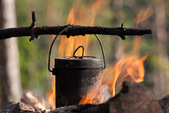 Kettle on a fire Royalty Free Stock Photos