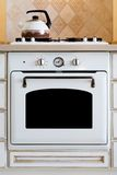 Kettle and gas cooker Stock Photos