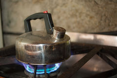 Kettle on gas flame Stock Image