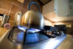Kettle on gass Stock Images