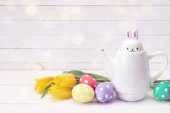 Kettle-hare with Easter eggs and yellow tulips on a white backgr Stock Images