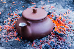 Kettle in hot coals Royalty Free Stock Images