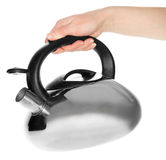 Kettle in man hand Stock Image