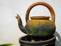 Kettle. Molds , baked clay , antiques , lemongrass , slough , lonely , mold the earth royalty free stock images