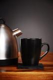 Kettle and mug Stock Photography