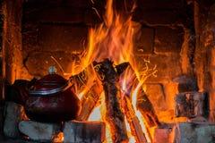 Kettle near fireplace Stock Image