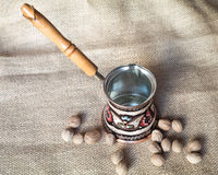 Kettle and nutmeg Royalty Free Stock Images