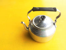 Kettle. The old retro kettle black handle made of aluminum on yellow background, space for text or copy Royalty Free Stock Images