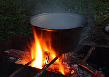 Kettle over campfire Royalty Free Stock Photography