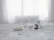 Kettle And Painting Supplies Covered In Dust Sheets Stock Photo