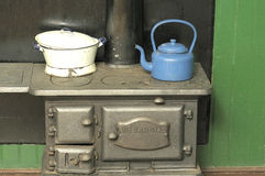 Kettle and pot on a coal stove stock photos