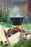 Kettle. Pot for cooking over a burning fire Royalty Free Stock Images