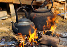 Kettle pot on fire Royalty Free Stock Image