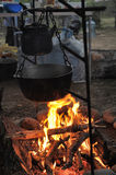 Kettle and pot on the fire. In the campaign Stock Photo