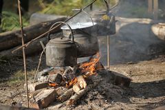 Kettle and pot on the fire. In the campaign Stock Image