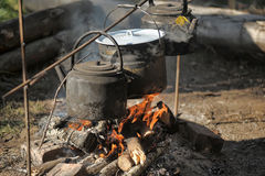Kettle and pot on the fire. In the campaign Stock Photography