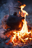 Kettle put in fire place outdoor Royalty Free Stock Images