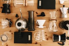 Kettle, scales, geyser, grinder, aeropress, pour over, glass flask top view. Alternative coffee brewing method set, flat lay. Stylish accessories and items for royalty free stock photography
