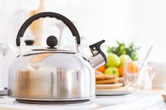 Kettle on the stove in the kitchen. Good morning or breakfast concept stock photography