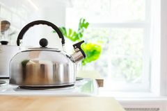 Kettle on the stove in the kitchen with the morning sunlight. Good morning or breakfast concept stock photos