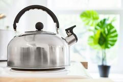 Kettle on the stove in the kitchen with the morning sunlight. Good morning or breakfast concept royalty free stock image