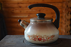 Kettle on the stove Royalty Free Stock Photos