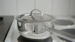 Kettle on stove- video with sound stock footage