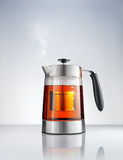 Kettle with tea Stock Image