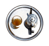 A kettle with a tea glass on a tray Stock Photo