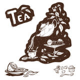 Kettle with tea. Tea is poured from a teapot into a cup Royalty Free Stock Photos
