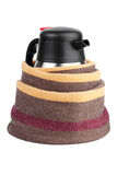 Kettle-thermos, wrapped in a woolen scarf Stock Photo