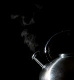 Kettle whistling, boiling kettle, steam,  on a black Stock Photos
