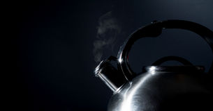 Kettle whistling, boiling kettle, steam,  on a black Stock Images