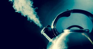 Kettle Whistling, Boiling Kettle With Steam Texture On A Black Background. Vintage, Grunge Style Photo. Stock Image